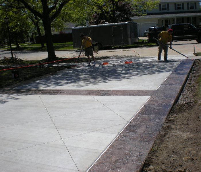Concrete Driveway replacement project with stamped border