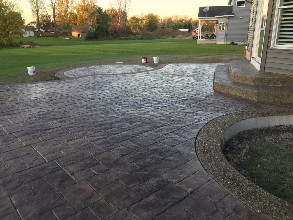 Stamped Concrete Patio With Exposed Aggregate Border